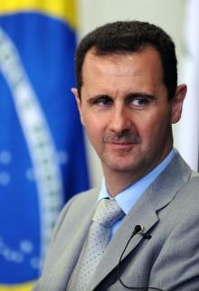Portret van Bashar al-Assad tijdens een bezoek aan het Brazilliaanse parlement