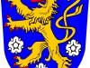 blauwe achtergrond, gele leeuw, witte bloemrosettem